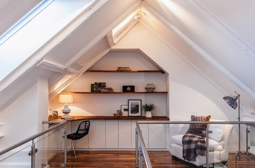 Another well done attic converted into a workspace and reading area.
