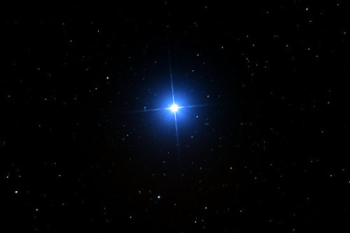 Vega is the fifth brightest star in the sky. Its name comes from the Arabic for the swooping eagle. Vega is about 25 light-years from Earth. It is three times the size of the sun and 50 times as luminous. Vega is located in the constellation Lyra.