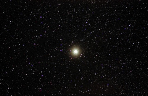 Capella is the sixth brightest star in the sky, Capella's name is from the Latin for little she-goat. Capella is a yellow giant star, like our own sun, but much larger. It is part of a binary star sysem with a red giant star. The two orbit around each other once every 104 days. Capella is approximately 41 light-years from earth. Capella is in the constellation Auriga.