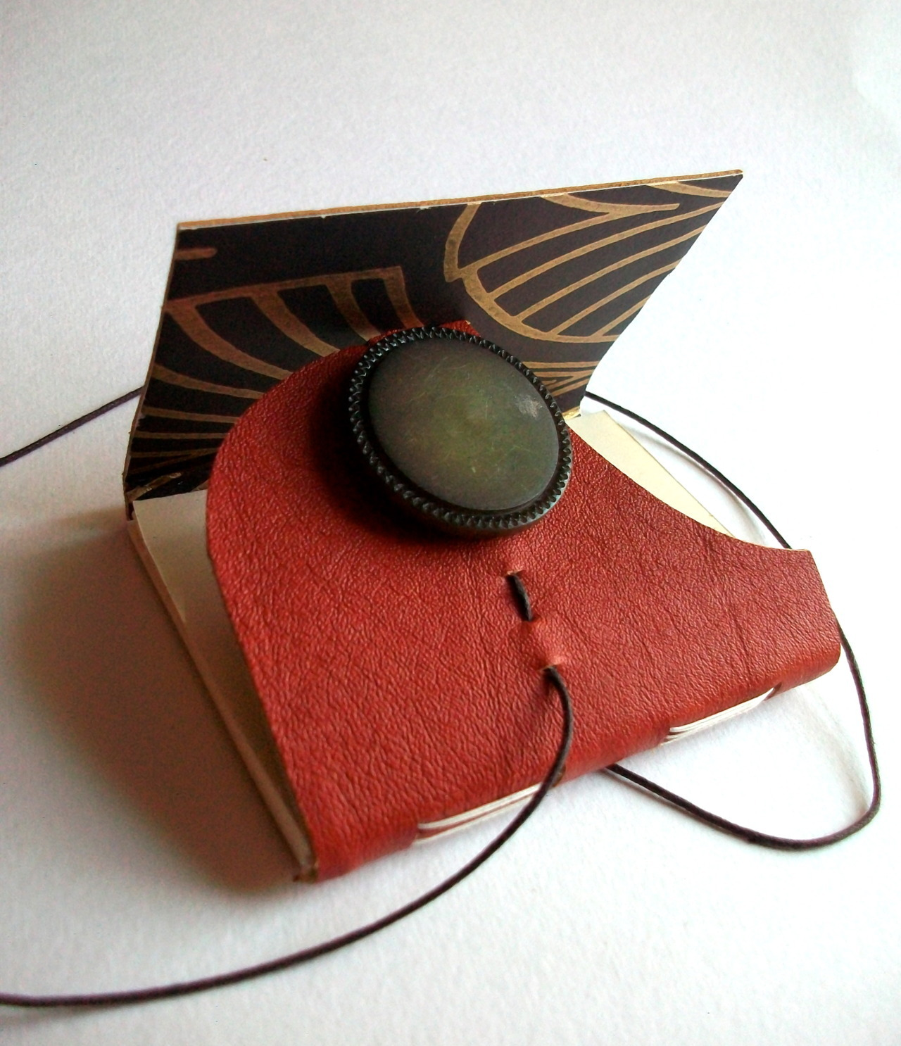 louisaboydart:  Hand bound, leather, wrap around journal with vintage button - 2012 Louisa Boyd