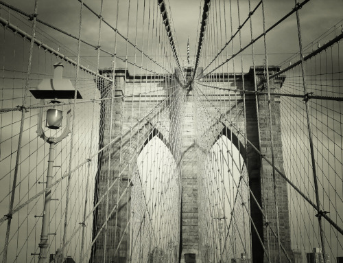 "nythroughthelens:  The Brooklyn Bridge. New York City. When the clouds pull their veils back from the sky's face after a storm, the light hits the world at such an angle that even the most rigid man-made creations glimmer like the water's surface in the sun. If you could distill New York City down to an essence so pure that it glimmered in such a way, it would look like this: captured, cooled, magnificent in its indistinguishable hand-woven-steel beauty. —- View this photo larger and on black on my Google Plus page —- Buy ""Distillation process - The Brooklyn Bridge - New York City"" Posters and Prints here, View my store, email me, or ask for help."