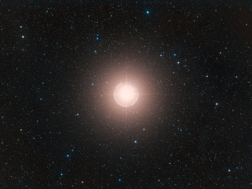 Betelgeuse is the tenth brightest star in the sky. It is a red supergiant about 13,000 times brighter than our sun and over 1000 times larger. If you placed Betelgeuse in the place of our sun, it would extend past the orbit of Jupiter. Its name is from the Arabic armpit, and is near the right shoulder of Orion. It is nearing the end of its life and will soon become a supernova. Betelgeuse is in the constellation Orion.