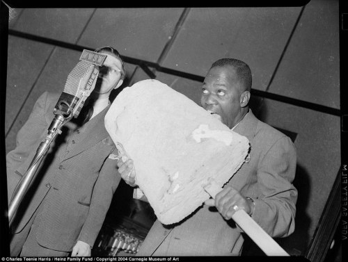 Bill 'Bojangles' Robinson eating an Eskimo Pie Ice Cream Bar.