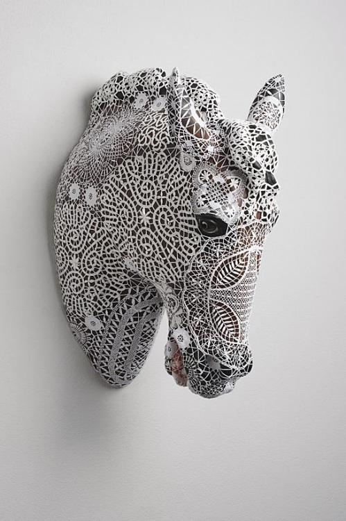 i love this. clagil:  TRIGGER by JOANA VASCONCELOS _ Gracefulness and Beauty. Made out of faience and cotton yarn. Here you can see more of her beautiful work.
