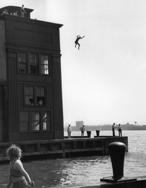 jumping into the hudson river, 1948 - by ruth orkin