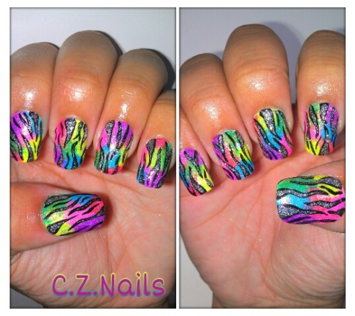 Colorful and Glittery Zebra Print Nails!! :)  I absolutely LOVE how these turned out. So bright and colorful. Perfect for the beginning of summer. I made a tutorial which I will be posting up soon :)