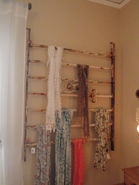 touchoftea:  metal railing #repurposed as scarf rack