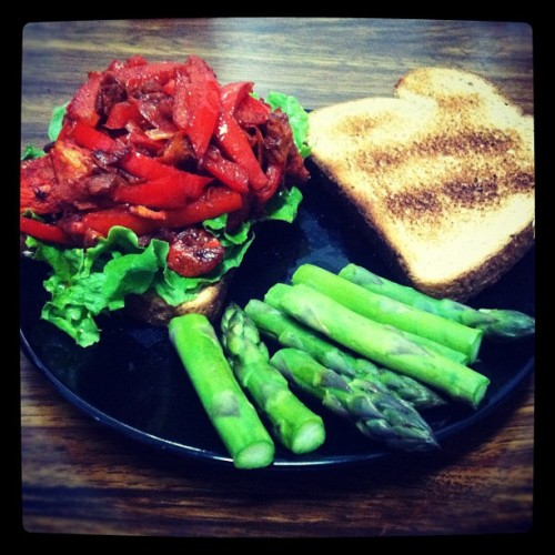 Tandoori chicken, shaved carrot and red capsicum toasted sandwhich w/a side of steamed Asparagus. First home cooked meal! (Taken with instagram)