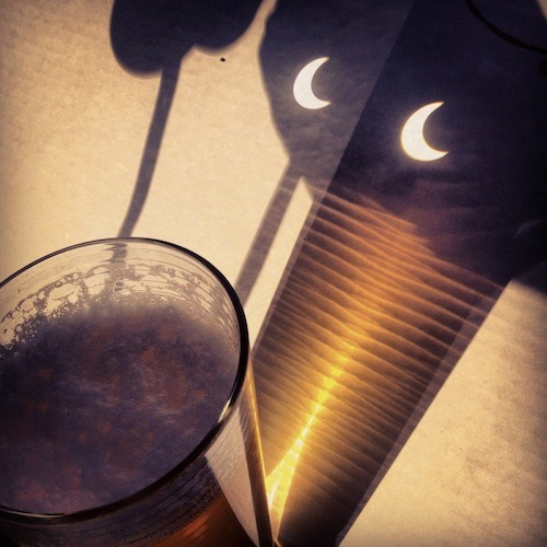 Solar beerclipse - Sunday night's solar eclipse passes over a pint of New Belgium Dig Pale Ale. Via draftmag.com — Did you catch the solar eclipse on Sunday?