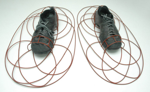 Pedro Reyes Dump Shoes (2006)  While doing research in a dump, my feet sank repeatedly into the trash. Inspired by snowshoes, I designed footwear for walking over garbage. For the time being this footwear can be very useful for dumpster diving, however, if the waste management problems of the world are not solved, it could prove to be an everyday item in the near future.