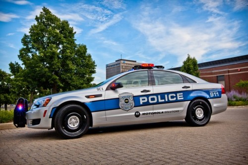 "The 2012 Chevrolet Caprice PPV is a futuristic cop car with 4G communications and a Knight Rider-like voice interface. It also automatically scans every license plate in its line of vision for warrants and unpaid tickets.  Police cars have come a long way since Car 54. Motorola Solutions, one of the world's leading security communications technology firms, recently unveiled a blinged-out next-generation cop car. The heavily modified 2012 Chevrolet Caprice PPV and Detective vehicle retails for approximately $30,000 before bid and bulk discounts and functions like a mobile police station. Motorola's re-outfitted Caprices feature a full array of cameras and an immersive computer system that turns it into, as CTO Paul Steinberg tells Fast Company, a ""virtual partner.""  Motorola's Police Car Of The Future Is An Unpaid-Ticket-Sniffing Scofflaw Slayer"