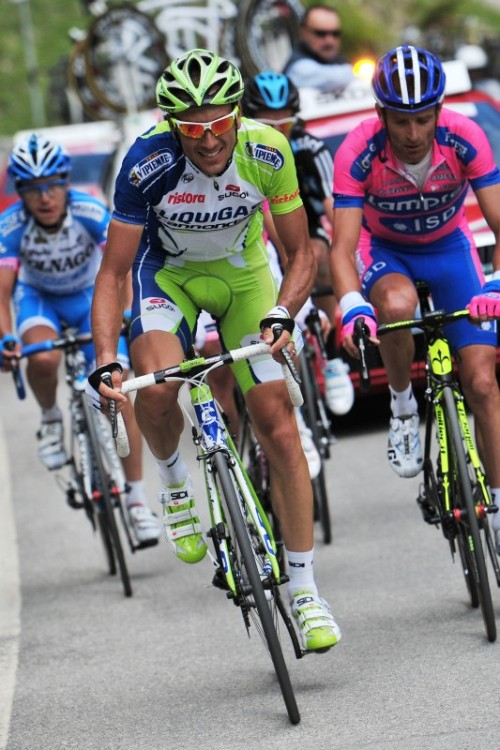 Ivan Basso like you've never seen him before: out of the saddle. The Italian is a bit of diesel who climbs very well but without intense bursts of power, preferring instead to asphyxiate his rivals with a high tempo. This might be the first photo I can remember where he's standing on the pedals. He rode strongly to eliminate several rivals and whilst it's too early to be sure, he might well have bought himself a podium spot with today's riding. Photo via RCS Sport.