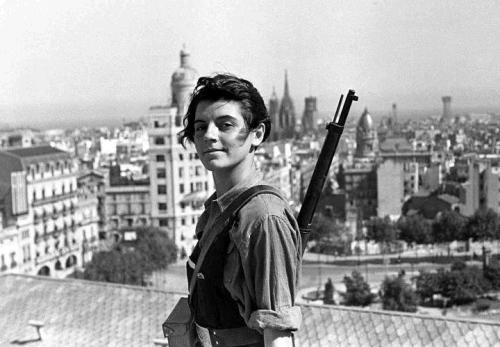 "whereangelsfear:  Marina Ginestá, Miliciana and member of the Communist Youth, taken in July 1936 at the penthouse of the Hotel Colón in Barcelona. Marina now in her 90s is apparently still alive and lives Paris (via Mona)  Stunning photo, taken 76 years ago today. A followup article was published here a few years ago wherein Marina is interviewed at the tender age of 89.  ""Es una buena foto, refleja el sentimiento que teníamos en aquel momento. Había llegado el socialismo, los clientes del hotel se habían marchado. Había euforia. Nos aposentamos en el Colón, comíamos bien, como si la vida burguesa nos perteneciera y hubiéramos cambiado de categoría rápidamente."" ""It's a good photo, it reflects the feeling of that moment. Socialism had arrived — the guests from the hotel had all left. It was euphoria. We were sleeping in the Colón Hotel, we ate well, as if we really belonged in the bourgeoisie and our station had changed overnight."""
