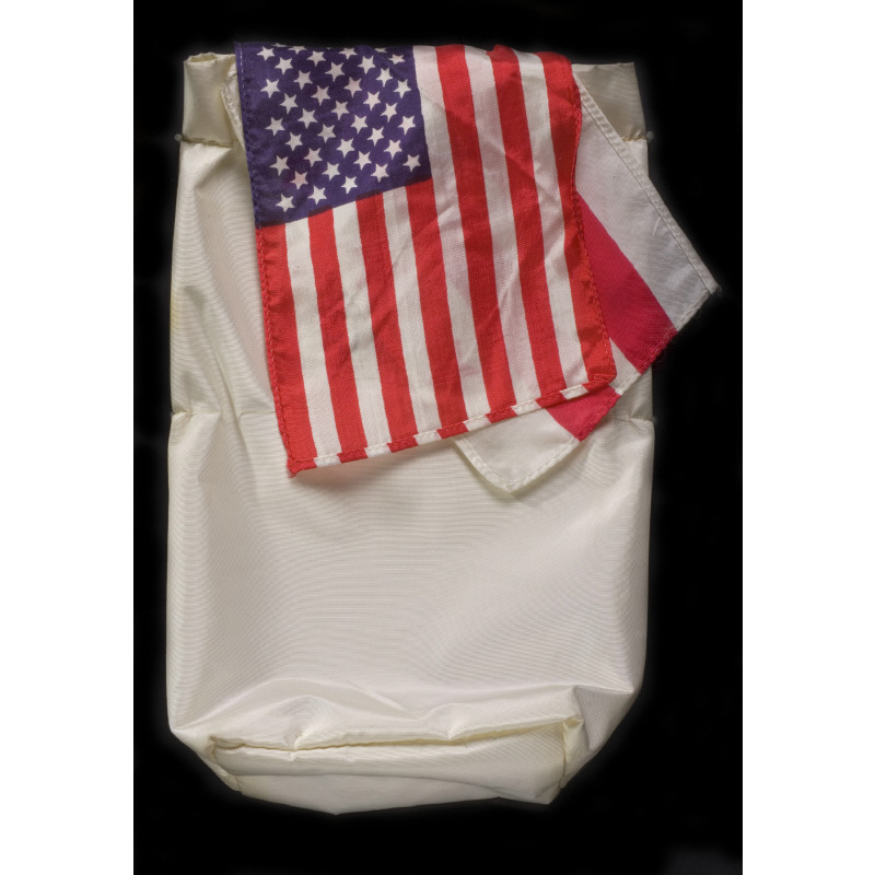 This small beta cloth bag was carried aboard the Apollo 11 flight by Michael Collins. It was his Personal Preference Kit, so named because all astronauts were permitted one small bag for personal or small items of significance they wished to carry into space. Among the items carried by Michael Collins were three flags; the US Flag, the flag of the District of Columbia, and the flag of the US Air Force.