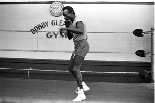 Miles Davis shadow boxing in Bobby Gleason's New York gym, 1969 (photo by Barry Wolman) Happy birthday, Miles.