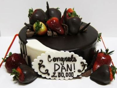 A cake for Dan because he hit 200,000 subscribers!posting because Phil told me (and everyone else), via twitter, to reply to Dan's announcement tweet, via twitter, a cake. and to do that id need a link. so im putting it here, so links can be a thing. whey.