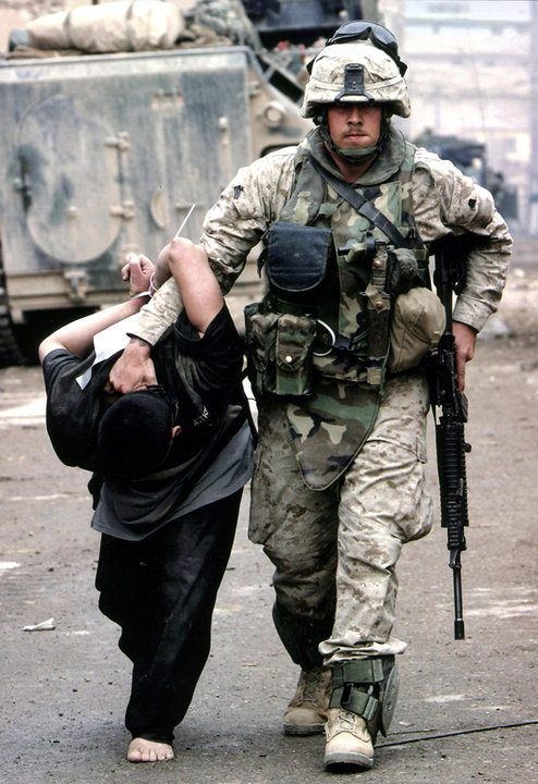 A Marine detaining a suspected insurgent near the town of Marjah in Helmand Province, August 20, 2010.