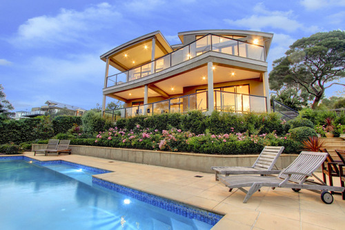 Melbourne Ranch House 05/21/12 Price: $1,500,000 Location: Melbourne, Australia This split-level ranch house in Melbourne, Australia, has well appointed entertaining areas as well as windows and balconies that were strategically placed to take advantage of the city and coastline views. —Patrick Brzeski The gardens have been planted with native Australian shrubs and flowers. Photo: Harcourts International Australia