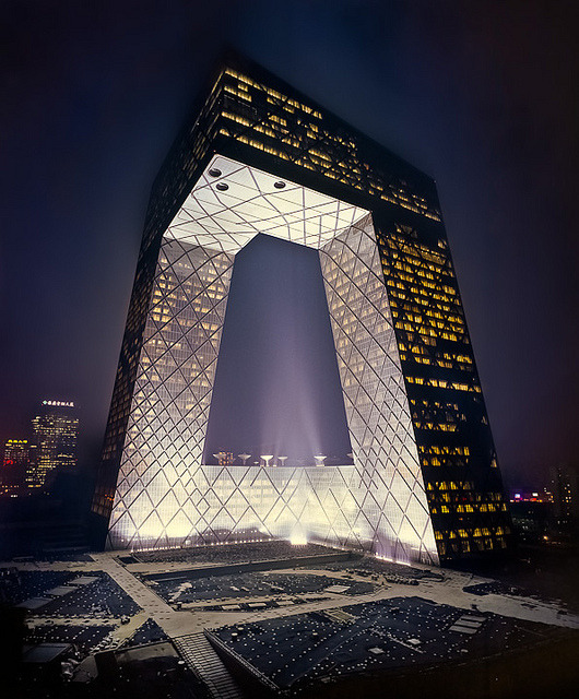 bauhauswife:  Here's another Koolhaas, the CCTV Building in Beijing. 2008. I'm pretty sure this is not how it actually looks at night, but it was the clearest picture I could find. What a gorgeous transformation of the basic skyscraper:')