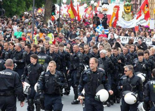 americawakiewakie:  From Occupy Frankfurt. The German police took off their helmets and marched with the protest clearing the way for them.Solidarity!