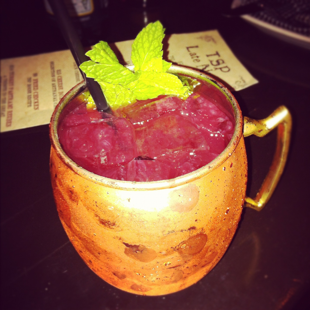 Ginger blackberry smash served in a copper mug