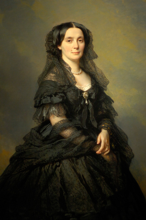 Elena Pavlovna Bibikova by Franz Xaver Winterhalter, 1860 Russia, the Walters Art Museum  Although born a peasant in the Black Forest region of southwestern Germany, Winterhalter became the foremost portraitist of European royalty and nobility. Hélène Bibikoff was initially married to Prince Esper A. Belosselsky-Belozersky and subsequently to Prince Kotschoubey, the son of the chancellor of the Russian empire. A woman of great wealth, even by the standards of her time, the Princess travelled extensively, mingling in the European courts, and entertaining lavishly. Her palace on the Nevsky Prospekt, St. Petersburg, was the setting for balls that rivaled those of the court in all its grandeur. She is reported to have maintained her role as a social leader at the imperial court with autocratic zeal. Winterhalter has depicted her in one of his customary formats, three-quarter length, nearly life-size, and painted against an overcast sky. She wears a black silk gown, black lace, and jewelry, including a necklace of large pearls, a pearl brooch with a large pendant pearl, a flexible, serpentine bracelet, and several rings.