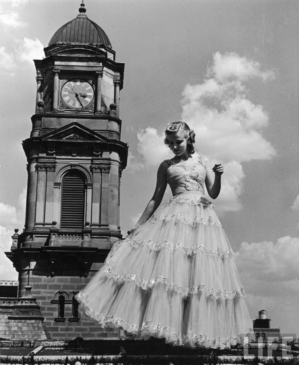 Alfred Eisenstaedt: Model clad in frilly party gown featuring tulle embroidered in paillettes for sale at Neiman Marcus for $195. Dallas, October 1939