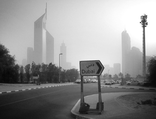 slightly dusty today in dubai … at least they let us know the directions (although a bit questionable)