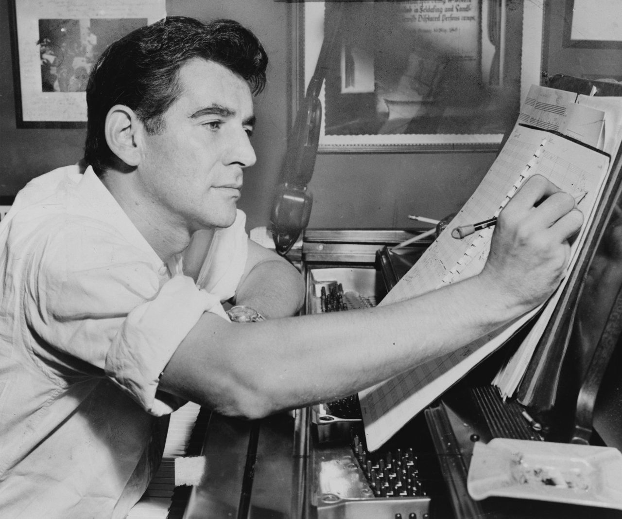 legrandcirque:  Al Ravenna, Leonard Bernstein seated at piano, making annotations to musical score, 1955. Source: Library of Congress. New York World-Telegram & Sun Collection