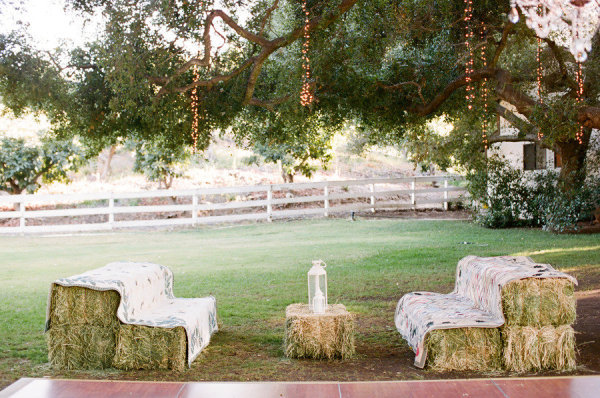 Using hay bales as seating is the perfect way to capture the rustic look on your wedding day.  Photo Credit: Picotte Weddings via Style Me Pretty