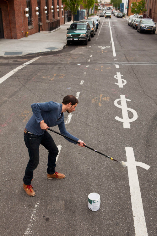 junkculture:  Street lines are dollar signs in Sebastian Errazuriz's latest art intervention.