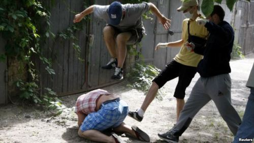 "Beaten Ukrainian Gay Activist Unbowed Sheremet tells RFE/RL that less than an hour before the march was scheduled to begin, police began questioning the organizers about the need for such an event. He says they alluded to letters of protest that had been sent to Kyiv city authorities, and said, ""Think about what you're doing. There are so many people against you and we cannot guarantee your safety."" They said as many as 2,000 right-wing radicals were planning to protest the gay pride march."