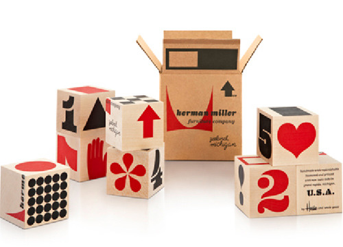 "Mini wooden blocks, ""Herman Miller Shipping Block"" by House Industries. ""This miniature representation of the Eames-designed Herman Miller shipping boxes features alphabetic elements from our Eames Century Modern font collection. We originally created the Shipping Blocks for Herman Miller Japan in 2010, but the folks in Zeeland liked them so much that they commissioned us to create a set for the U.S. market."""