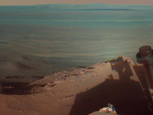 theatlantic:  Science Picture of the Day: The Mars Horizon  NASA's Mars Rover Opportunity captured this image looking eastward over the Endeavour Crater late in the afternoon of Opportunity's 2,888th Martian sol (day) which corresponded with March 9, 2012 here on Earth. In the foreground, Opportunity's own shadow appears, in a sort of one-step-removed self-portrait. […] The image is a mosaic of about a dozen images and presented in false color to draw out certain features of the topography. [Image: NASA]