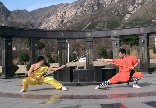 From my Shifu's blog. He's in yellow, on the right. I believe this was taken a few years earlier, here in Dengfeng. shaolinshifu:  During a training in China