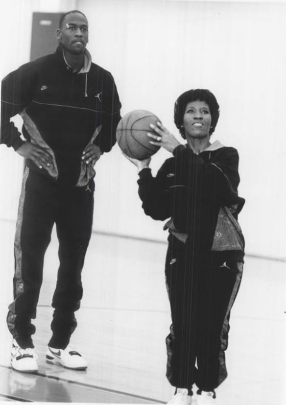 jordandigest:  Deloris shows Michael how to shoot the rock.