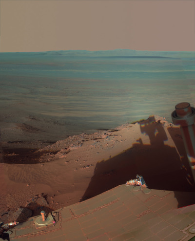 discoverynews:  Mars Rover Snaps Stunning Self-Portrait NASA put together this artsy image of Mars rover Opportunity getting a glimpse of its own shadow on the rim of Endeavour Crater. The robotic geologist used its panoramic camera to take about a dozen shots using an assortment of filters between about 4:30 and 5 p.m. Mars time on March 9. The images were transmitted back to Earth where a team of scientists assembled them into this mosaic, which was released Wednesday. keep reading  Stunning! Stunning is indeed the word to use for this photo!
