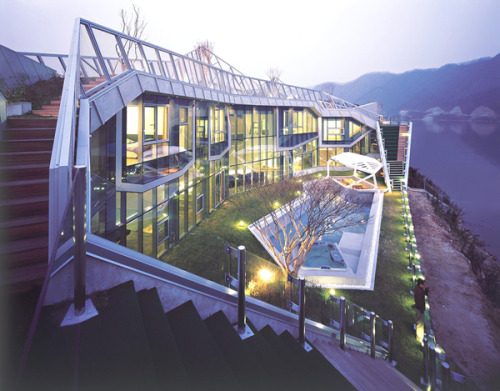 The home is located in Gapyunggun, Gyeounggi-do, South Korea. The intention was for the design to become a part of the surrounding context, which consisted of the river and mountains.  Island House by Iroje KHM Architects