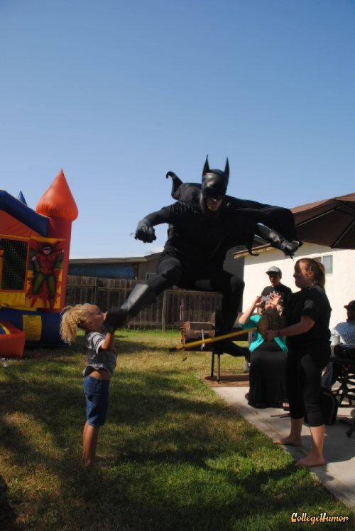 Batman Kicks Kid in the Face The hammer of justice makes no exceptions.