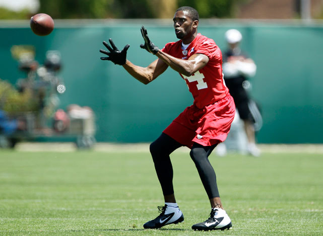 New 49ers wide receiver Randy Moss catches a ball during practice at the team's training facility in Santa Clara, Calif. on Thursday. Moss has been a model teammate so far in 49ers camp, says SI's Ann Killion, and has taken fellow receiver Michael Crabtree under his wing. (AP Photo/Paul Sakuma) KILLION: Moss doing all the right things in San FranciscoGALLERY: Rare Photos of Randy Moss