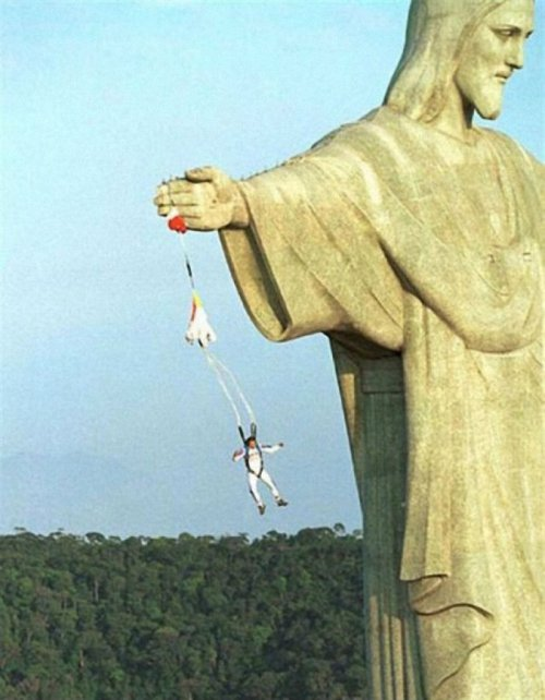 "cityblue30:  collegehumor:  Parachute Snagged on Statue of Jesus And the lord reached out his hand, and the man said, ""Can you put me down now?"""