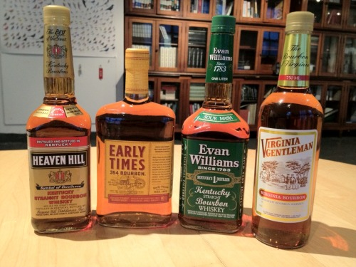 "Our mid-week tasting featured four familiar whiskies at a mellow 80 proof each: Heaven Hill, Early Times, Evan Williams (Green), and Virginia Gentleman. These are all very reasonably priced bottles and I didn't know what to expect when stacked against one another. Clay said, ""I think you'll be surprised."" Smooth. Classic mash flavor profiles: a little citrus, wood, honey sweetness, even barley. Each quite different…and good. Clay called one ""session whiskey""; when you plan to make a whole night of it. I like that."