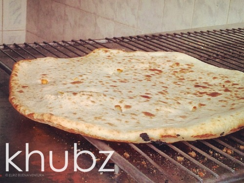 elriz:      Khubz. Khubz, an Arabic word for bread, but usually used by non-Arabic speakers (pronounced as kuboos) to refer to a flatbread that forms a staple of the local diet in Arabic-speaking countries from the Arabian Peninsula to Morocco.* Cooked inside an oven called tandoori, this flatbread can be stuffed with bits of cheese and be glazed with honey or sugar syrup. This actually makes a good (and heavy) breakfast.