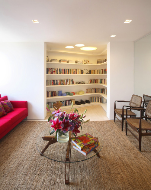 I love the integration of the library into the living room without overtaking the space