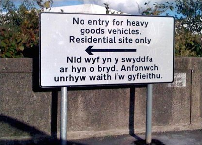 "The sign above is in English and Welsh. But the Welsh words do not, when translated, match the English. Rather, as explained by this BBC article, it means ""I am not in the office at the moment. Send any work to be translated."" The sign maker misunderstood the translator's ""Out of Office"" message to be the translation."