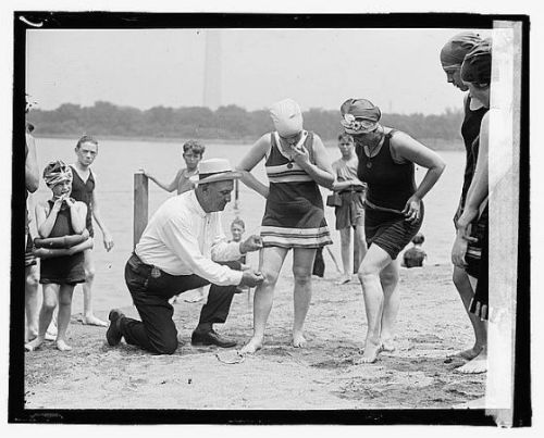 D.C. policeman Bill Norton measures the distance between women's knees and the bottom of their bathing suits at the Tidal Basin bathing beach in June 1922. That summer, the superintendent of D.C. public buildings and grounds ordered that suits not be more than six inches above the knee. Let's hope Officer Norton isn't in Rehoboth Beach, Del., this weekend…