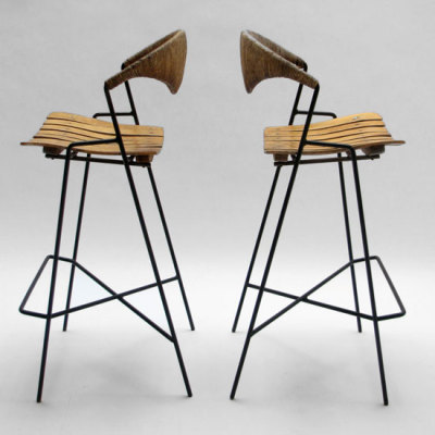 1950's. Bar Stool designed by Arthur Umanoff made in U.S.A. Wrought iron frames, wood slat seats and rush backing.
