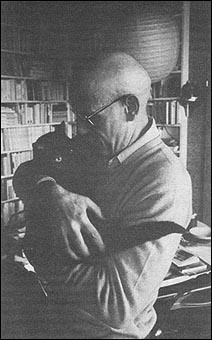 Bald Foucault and black kitty.