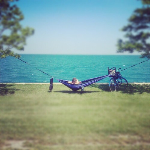 On my bike ride on the lakefront path, i saw this girl set up a hammock inbetween two trees. Awesome.