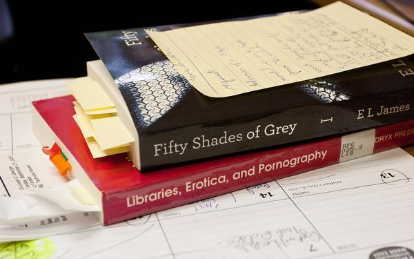 """Fifty Shades of Grey"" readers face long wait at Colorado libraries Want to borrow ""Fifty Shades of Grey?"" It's going to be a long, heart-pounding wait at the local library. All 185 print, 50 eBook and 14 audio book copies of the first of volume of E.L. James' adult erotic trilogy are checked out of the Denver Public Library and 1,424 people had placed holds by early Thursday afternoon. Those numbers are growing by the hour, library spokeswoman Jen Morris said."